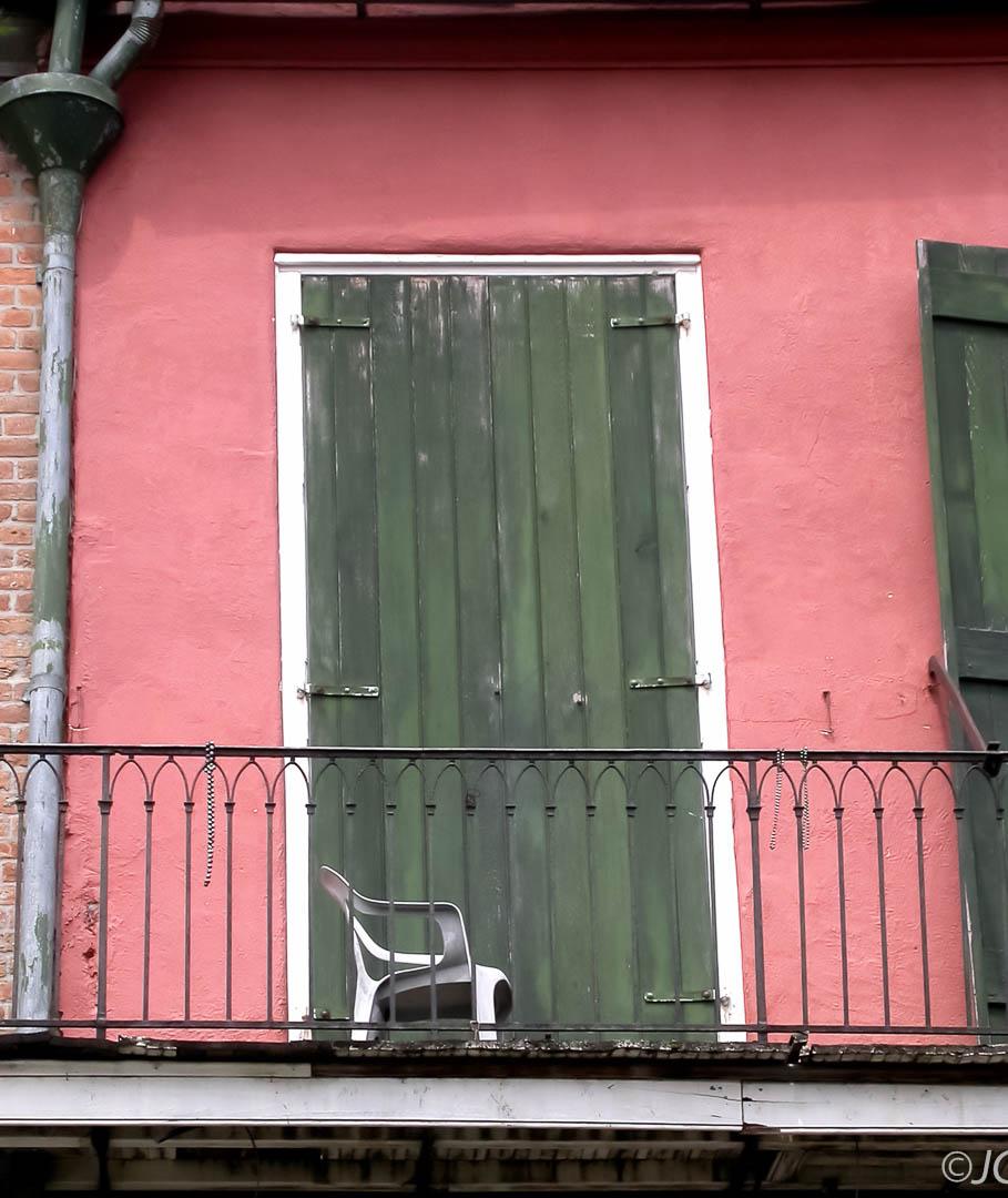 Green Doors, White Plastic Chair
