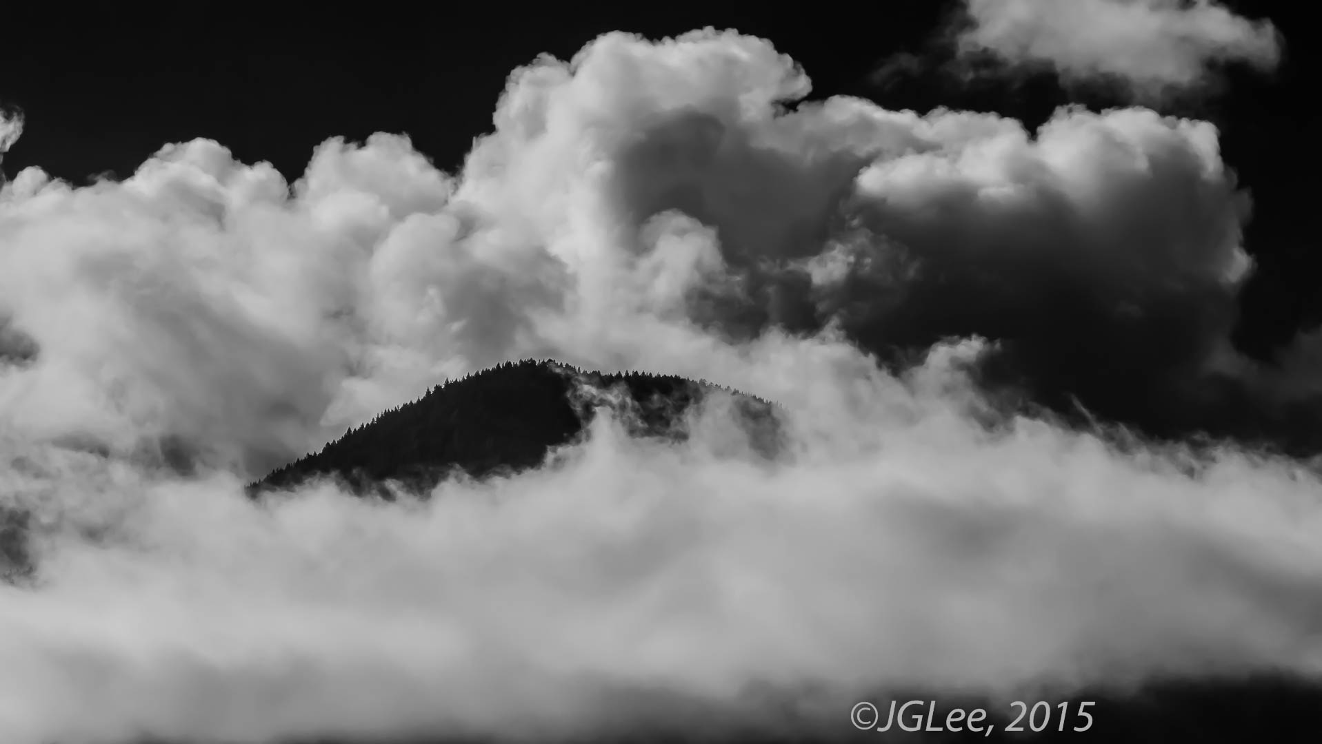 Mountain Top in Clouds